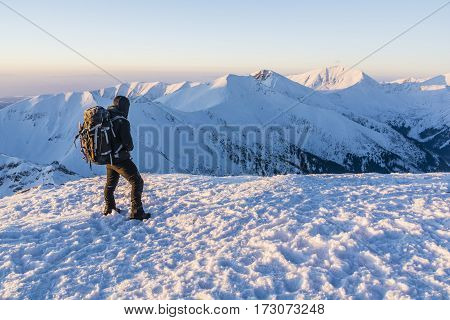 Man With The Backpack Enjoy Mountain Views In Winter.