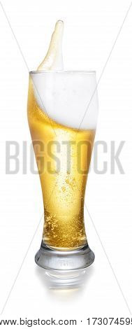 glass of splashing beer isolated on white background with clipping path. Glass with beer up. Golden beer splash