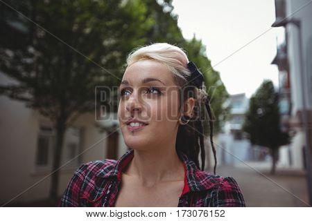 Portrait of beautiful woman standing in street
