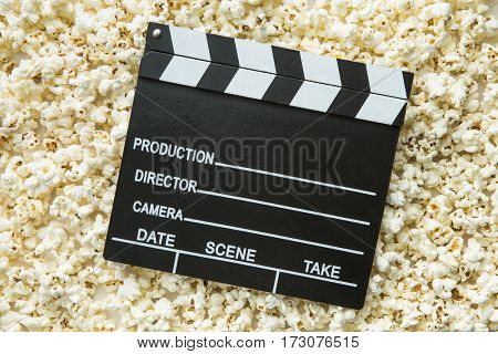 Clapperboard and popcorn. Top view.