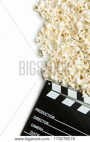 Clapperboard and popcorn. Top view. Isolated on white background.