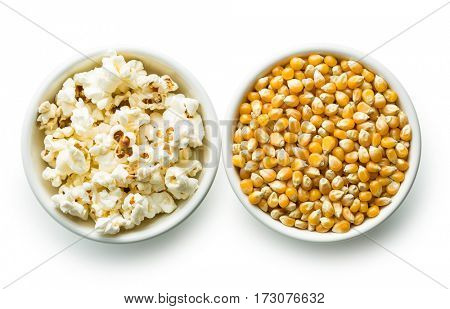 Popcorn and corn seeds in bowl isolated on white background.