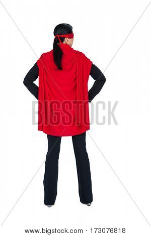 Rear view of woman pretending to be a super hero on white background