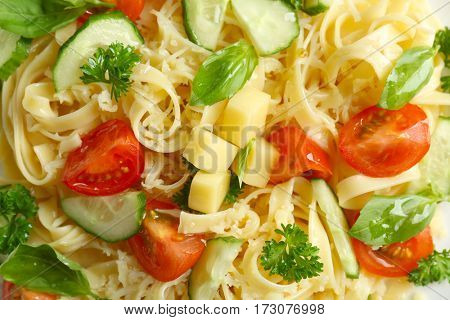 Pasta salad with tomatoes and cucumber, closeup