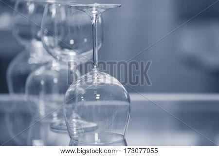 Upturned wine glasses on table