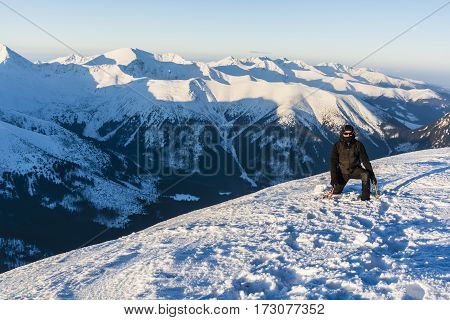 Man With Ice Axes In The Mountains.