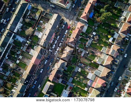 London suburbs, aerial view. Aerial drone photo looking down vertically onto the rooftops of a typical North London suburban district.