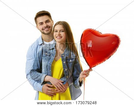Cute young couple with balloon in shape of heart on white background