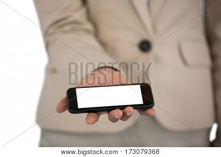 Mid section of Businesswoman holding mobile phone on white background