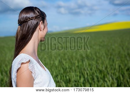 Close-up of woman looking at field on a sunny day