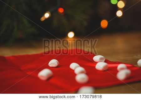 Sweet marshmallow on wooden table during christmas time