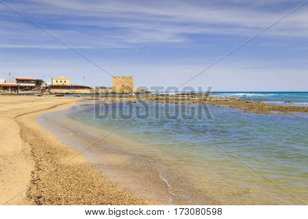 Summer holidays: Torre Santa Sabina beach (Brindisi).Italy (Apulia).The tower of Santa Sabina has star-shaped with four corners oriented to the cardinal points, with embattled crowning.