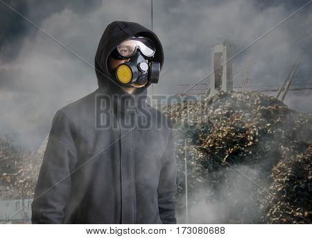 Pollution And Toxic Waste Concept. Man With Gas Mask In Front Of
