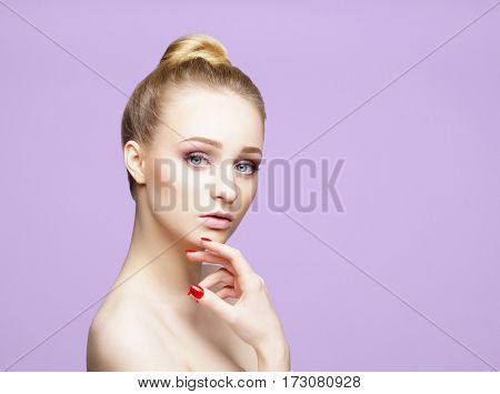 Beauty close-up portrait of beautiful, fresh and healthy girl over magenta background.