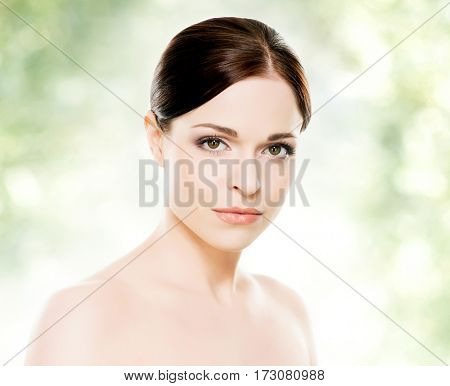 Close-up portrait of beautiful, fresh, healthy and sensual girl: over green background. Healthcare, spa, makeup and face lifting concept.