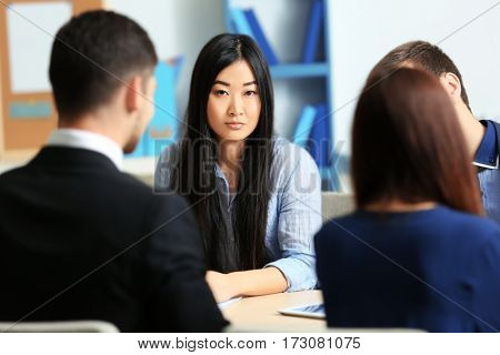 Businesswoman with colleagues in conference room