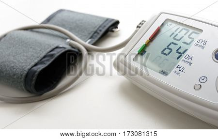 Digital blood pressure mesuring monitor on white table