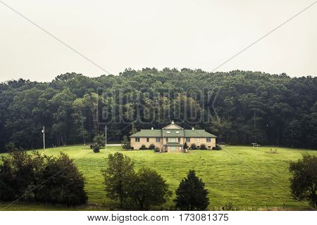 A large estate on a hill in the countryside of southern USA