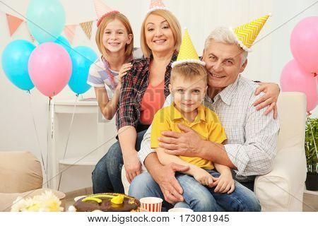 Grandparents and children celebrating Birthday