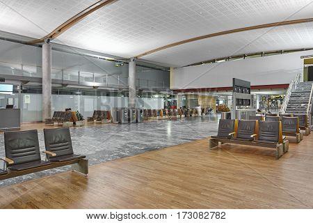 International airport interior terminal. Departure waiting area. Gates hall. Horizontal