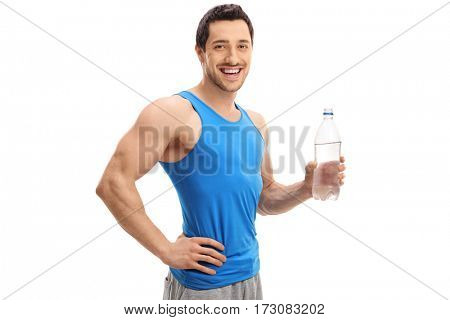 Athletic young man with a bottle of water smiling and looking at the camera isolated on white background