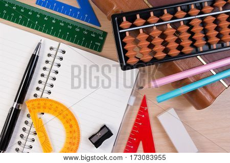 Pen And Abacus Over Old Vintage Book For Mathematics Class In School. Vintage Mathematics Book With