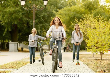 Cute girl riding bicycle in park