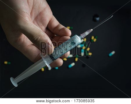 potrait a medical/healthcare instrument of syring and needle for injection drugs