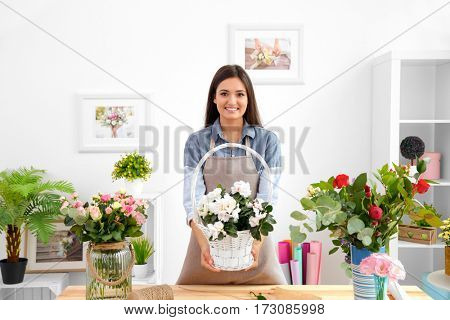 Pretty young florist at workplace