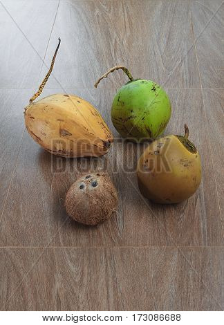 Four different coconuts on table top view
