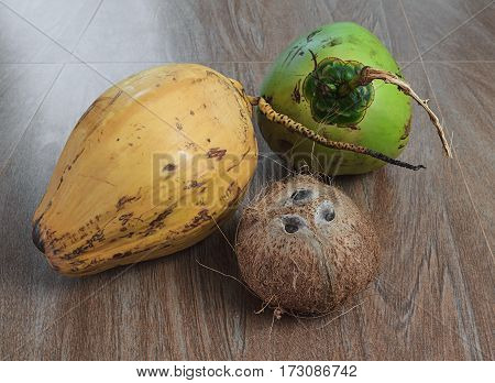 three different coconuts on table horizontal view