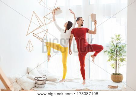 Man and woman practicing sports at home.