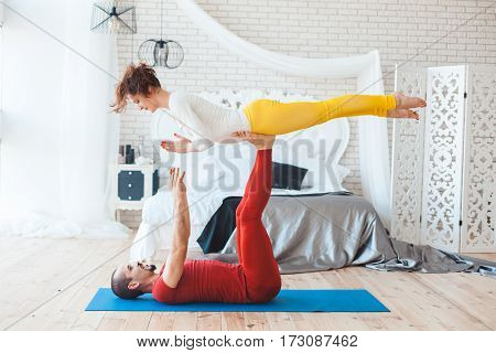 Family morning exercise at home in the bedroom.