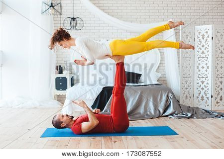 Man and woman practicing yoga they trained at home.