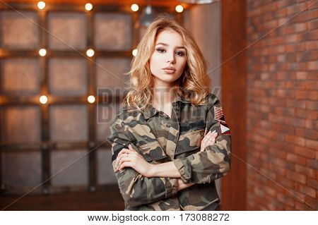 Stylish Young Beautiful Woman In Trendy Military Jacket On A Background Of Lights