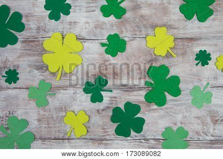 Background Leaf Clover Shamrocks And Quatrefoils On Wooden Table