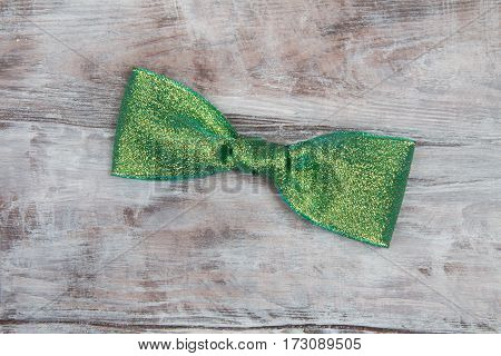 Handmade Bow Made Of Shiny Green Ribbon On Gray Wooden Background