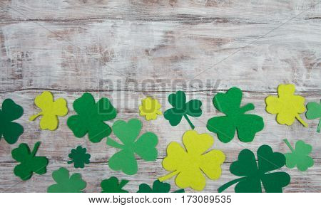 Clover Leaves Made From Felt On Wooden Background. Patricks Day