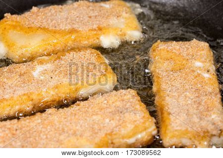 Frying Fried Yellow Cheese With Eggs In Frying Pan