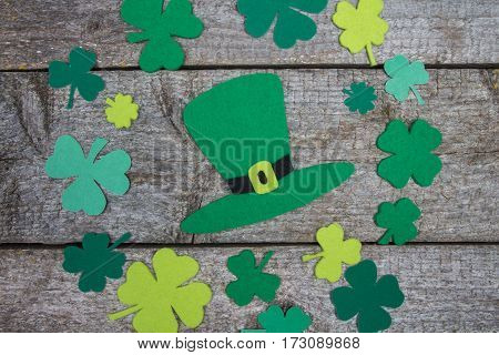 Handmade Hat Patrick And Range Of Leaf Clover On Table.