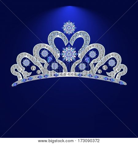 silver wedding female hair ornament with precious stones on a blue background