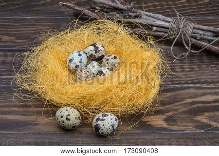 Nest Of Sisal With Quail Eggs On Wooden Rustic Background