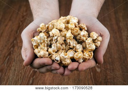 people gaining a bunch of popcorn close up