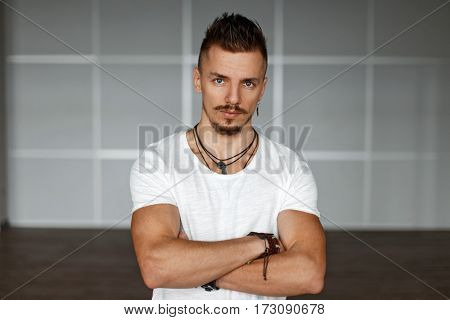 Stylish Handsome Guy In A White Shirt Near The Wall