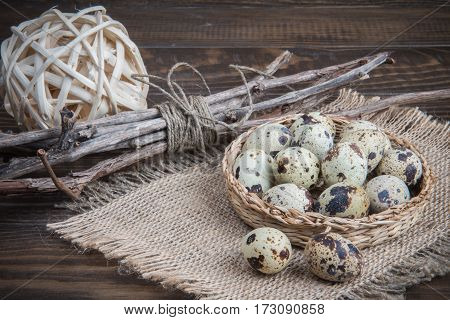 Easter Still Life Quail Eggs, Wicker Plate With Twigs And Burlap