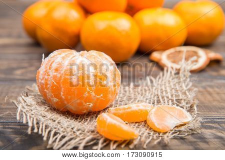 Juicy Ripe Tangerines And Slices Of Fruit On Sackcloth