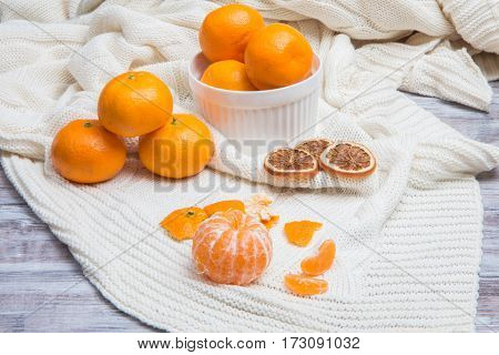 Peeled Tangerine, Whole, Dried And Slices On White Knit Plaid