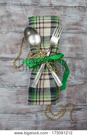 Cutlery Fork, Spoon On Checkered Napkin Tied With Ribbon