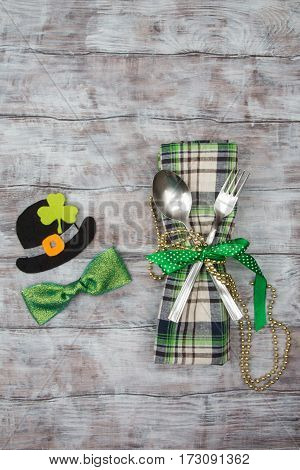 Spoon, Fork, Napkin And Decoration St. Patrick On Wooden Table