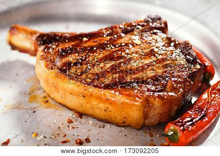 food meat - beef steak on vintage metal plate, Shallow dof.
